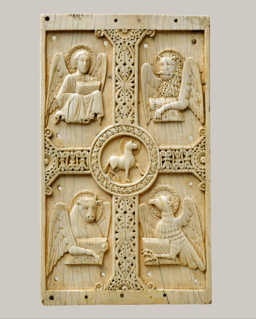 Represented here by their characteristic attributes are the four evangelists surrounding the Lamb of God (Agnus Dei), as derived from the vision of John in the Book of Revelation (4:6–7): an angel (Matthew), a winged lion (Mark), a winged ox (Luke), and an eagle (John). Originally this plaque would have covered a deluxe binding of a now-lost Gospel book. The stylization of the symbols and the type of interlaced foliate cross find parallels in manuscript illumination produced within the southern Italian region of Benevento, including at the famed Benedictine monastery of Monte Cassino.